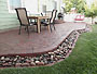 curved patio paver blocks with cobblestone border accent